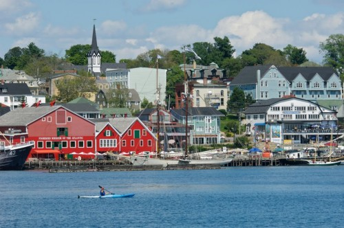 Kayaker has excellent view of Lunenburg waterfront - Credit Photo Nova Scotia Tourism